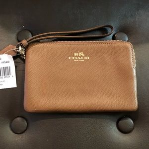 Coach (new with tags) luggage color wristlet